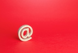 Email figure on red background. AT commercial symbol. Contacts communication. Business representations on Internet and social media. Concept of e-mail address. Internet provider services