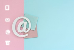 Email symbol on blue and pink background. Concept for email, communication or contact us