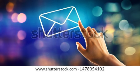 Email with hand pressing a button on a technology screen