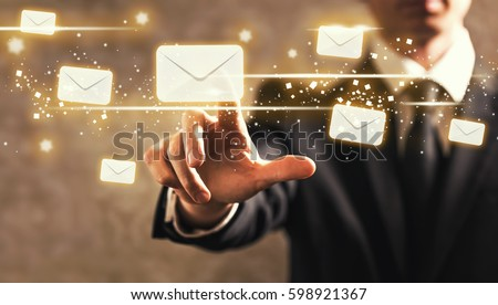 Emails with businessman on dark vintage background #598921367