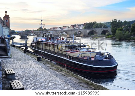 Embankment of Regensburg city at sunset, Germany - stock photo