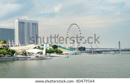 Embankment of Singapore and Singapore Flyer in the sunshine day