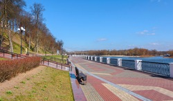 Embankment of the Sozh River in Gomel. Gomel palace and park ensemble. Pedestrian bridge over the Sozh river. View of the embankment from Swan Pond to the pedestrian bridge. Gomel. Belarus