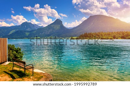 Embankment promenade at the Wolfgangsee lake in Austria. Wolfgangsee is one of the best known lakes in the Salzkammergut resort region of Austria. Village St Wolfgang on the lake Wolfgangsee, Austria