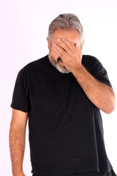 Embarassed man in shame covering face