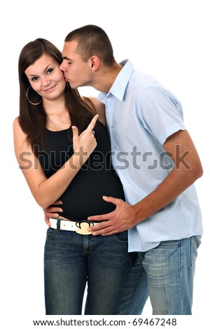 Embarrased young girl pointing finger to her boyfriend isolated on white