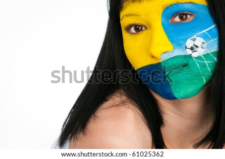 Emblem club Metalist painted on her face - stock photo