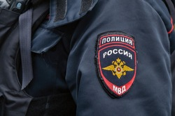 Emblem of russian police sewn on the sleeve of russian police uniform. Translation of writings: police, Russia,Ministry of interior