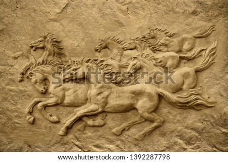 Emboss 3D stone carving seven running horses on decorative textured wall background 3D wallpaper. Graphical poster modern artwork #1392287798