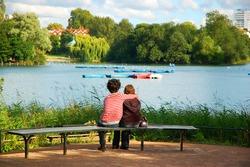 Embraced lovers on a bench at Regent's park, London. UK