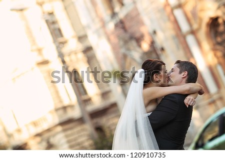 embracing bride and groom