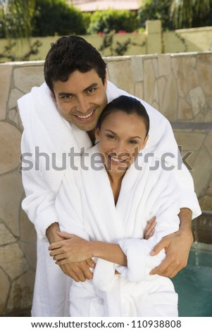 Embracing couple in bathrobe
