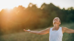 Embracing the positive energy with open arms, creating affirmative sensations, feeling energized