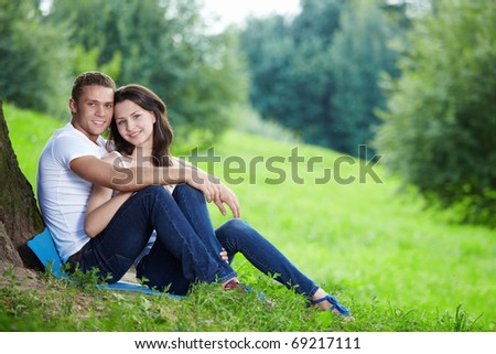 Embracing young couple in the park