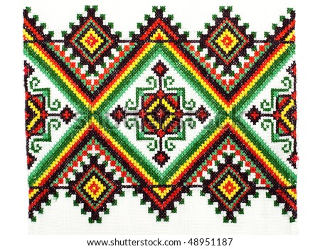 embroidered handmade good by cross-stitch pattern. ethnic colorful pattern