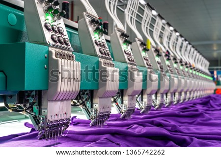 Embroidery area in textile factory in industrial zone in Ho Chi Minh City, Vietnam, with modern machinery and technology systems.