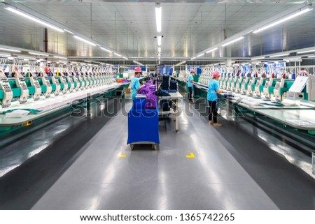 Photo of Embroidery area in textile factory in industrial zone in Ho Chi Minh City, Vietnam, with modern machinery and technology systems.