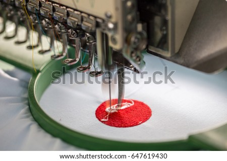 Embroidery machine needle in Textile Industry at Garment Manufacturers, Embroidery needle, Needle with thread (selective focus and soft focus)