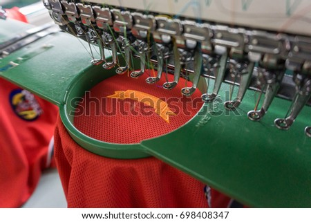 Embroidery machine needle in Textile Industry at Garment Manufacturers, Embroidery t-shirt in progress , Embroidery needle, Needle with thread (selective focus and soft focus) #698408347