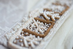 Embroidery of a traditional russian headdress in the technique of pearl sewing.
