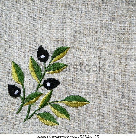 Embroidery of olive branch on linen beige fabric can use as background