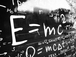 Emc2 formula on black wall. Science background image.