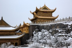 Emeishan, Mount Emei, Sichuan Province China. Sacred Buddhist Mountain. Snow Covered Mountain, Golden Chinese Buddhist temple in the snow. Winter scenery, ice and snow. Translation:
