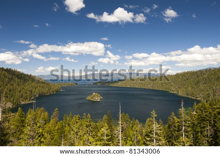 Emerald Bay with beautiful cloudy sky and green tree in the foreground, South Lake Tahoe, California, USA