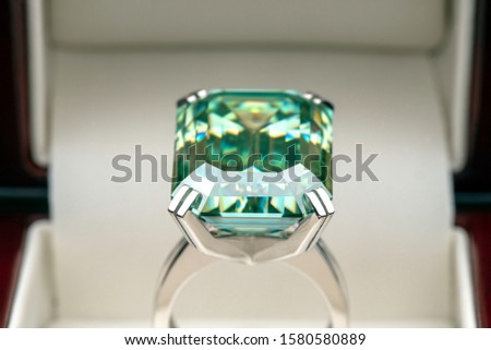Emerald Cut Blue Diamond Ring in Jewelry Box Stok fotoğraf ©
