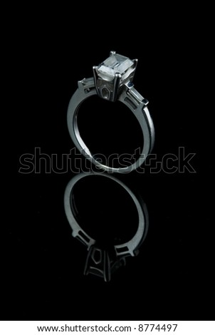 Emerald Cut Enagement Ring with Diamond Begets