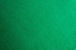 Emerald knitted woolen fabric texture for wallpaper and an abstract background.