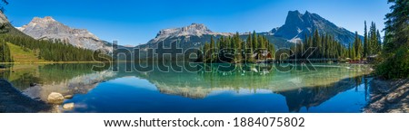 Emerald Lake panorama view in summer sunny day. Michael Peak, Wapta Mountain, and Mount Burgess in the background. Yoho National Park, Canadian Rockies, British Columbia, Canada. Stock photo ©