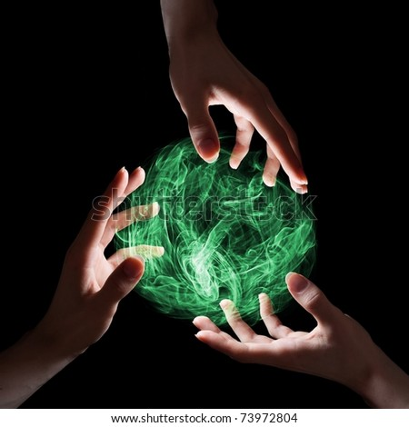 Emerald magical sphere held by three hands.