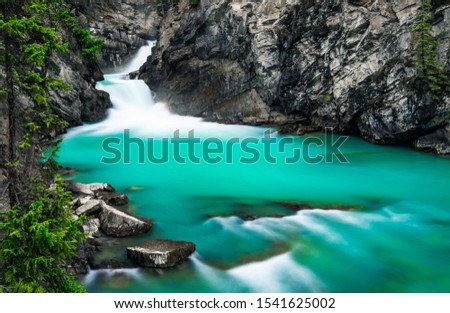 Emerald Slow Shutter Glacier Waterfall River Through Mountain Rock Canyon #1541625002