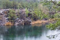 Emerald water in the Korostyshevsky quarry. Flooded quarry in the city Korostyshiv.