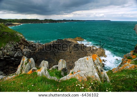 Emerald waters of Atlantic ocean at the rocky coast of Brittany, France
