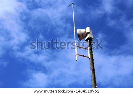 Emergency alert siren with blue sky and clouds #1484518961