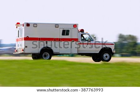 Emergency ambulance driving very fast