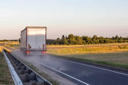 Emergency braking of a loaded truck on dry asphalt. Safety concept and stopping distance with ABS, copy space