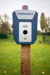 Emergency button outdoor in city park. Police, panic call button