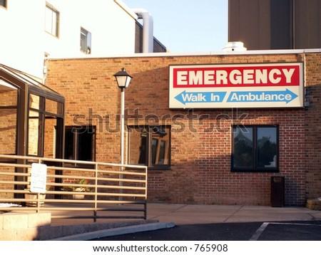 Emergency entrance sign for walkins and ambulances shot in natural light.