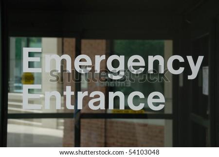 Emergency Entrance sign on sliding glass door.