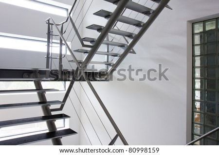 Emergency exit by a stairwell in a modern building - stock photo