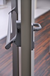 Emergency exit door. Closed up latch door handle of emergency exit. Push bar and rail for panic exit