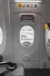 Emergency Exit Sign on Door in Airbus Plane Interior