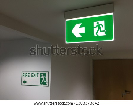 Emergency fire exit sign in offices.