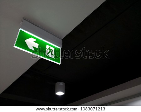 Emergency fire exit sign show the way to escape.