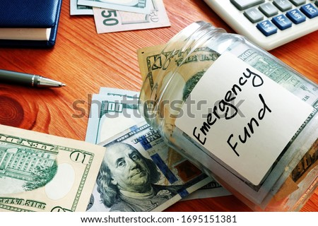 Emergency fund in the glass jar with cash. Stock foto ©