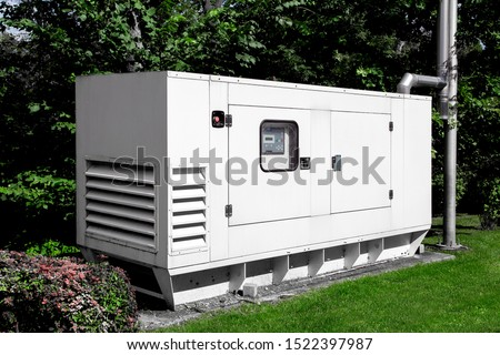 emergency generator for uninterruptible power supply, diesel installation in an iron casing with an electric switchboard power management. Foto d'archivio ©