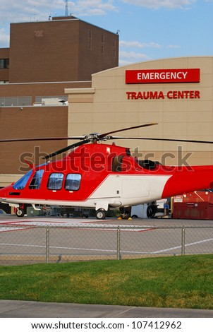 Emergency medical helicopter sitting outside a trauma center.